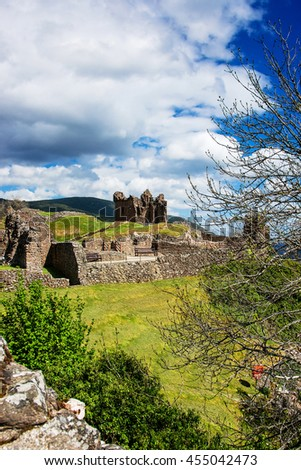 Remainings of the Urquhart Castle at Loch Ness in Scotland. Loch Ness is a city in the Highlands in Scotland in the United Kingdom. - stock photo