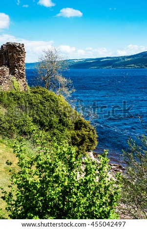 Remainings of the  Urquhart Castle in Loch Ness of Scotland. Loch Ness is a city in the Highlands in Scotland in the United Kingdom. - stock photo
