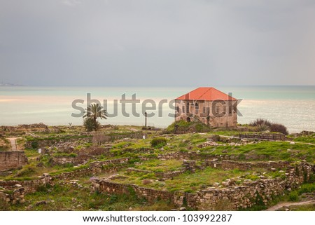 Remains and ruins of ancient seacoast civilization in Byblos, Lebanon on a gray overcast cloudy day with the sea in the background. This is a high dynamic range image. / Ruins in Byblos Lebanon - stock photo
