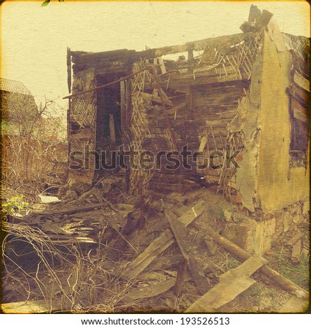 Remains of a burned down house, grunge retro photo effect. - stock photo