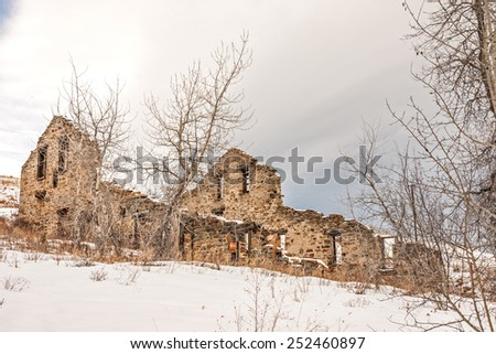 Remains of a twenty-stamp gold mill built in 1883 in Montana on a winter day - stock photo