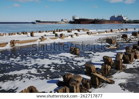 remains of a wooden pier and ships in port in Petrozavodsk, Russia - stock photo