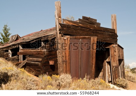 Remains of an automotive repair shop in a Montana ghost town - stock photo