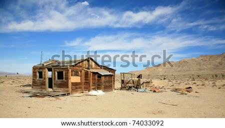remains of an old gold mine ghost town in nevada or californias wild west days of the 1800's - stock photo