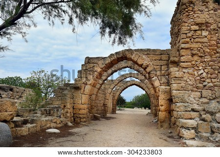 remains of the archs over the main streets of the ancient city of Caesarea, built by the Crusaders during the Crusades, Israel - stock photo