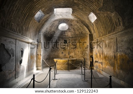 Remains of the public baths in Pompeii, the famous roman city near Naples (Italy) that was completely destroyed by the eruption of Mount Vesuvius in 79BC. - stock photo