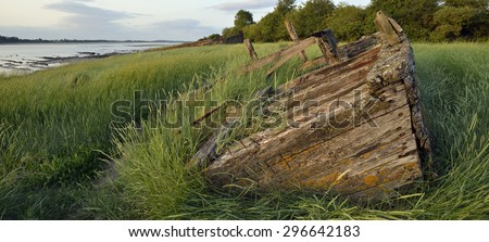 Remains of the Severn Collier, built in Stourport 1937, and beached at Purton in 1965 to help prevent the River Severn erroding into the Gloucester Sharpness Canal - stock photo