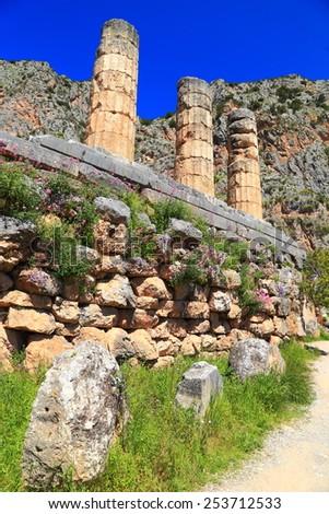 Remains of the temple of the sun god Apollo, Delphi, Greece - stock photo