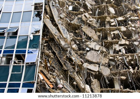 remarkable ruins of building under destruction with part of the surface wall and windows still intact - from a series - stock photo