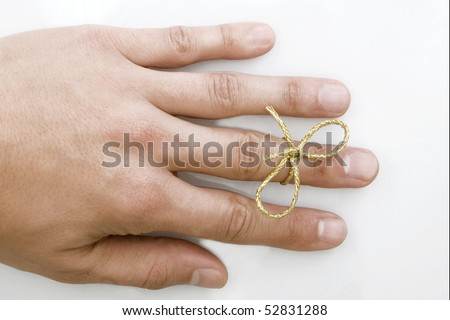 remember concept, caucasian hand with gold tie - stock photo