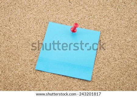 Reminder sticky note on cork board - stock photo