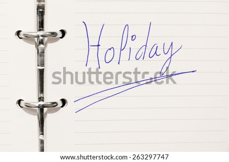 reminder with holiday word on organizer - stock photo