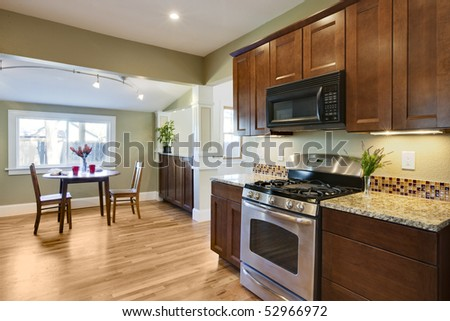 Remodel kitchen with oven and granite counters - stock photo