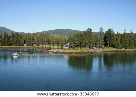 Remote cabins along the Wrangell Narrows in Southeastern Alaska - stock photo