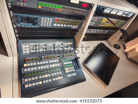 remote control at the TV studio - stock photo