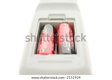 Remote control battery compartment, isolated over white, close-up - stock photo
