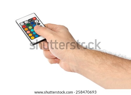 Remote control for change colors in hand isolated on white background - stock photo