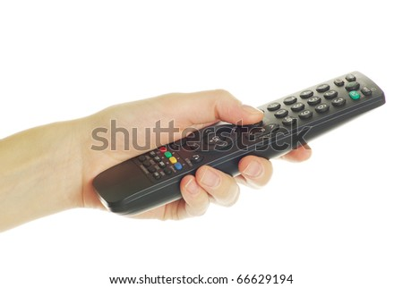 remote control in hand - stock photo