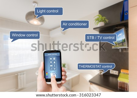 Remote home control system on a digital tablet or phone. - stock photo