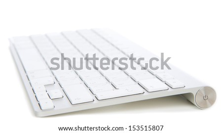 Remote wireless computer office keyboard on a white background - stock photo