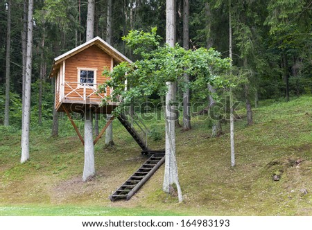 Remote wooden tree house in the forest - stock photo