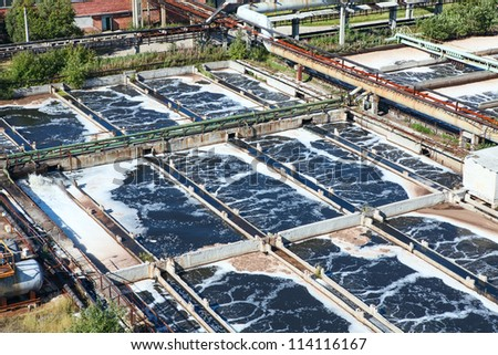 Removing chemical and biological contaminants on sewage treatment plant - stock photo