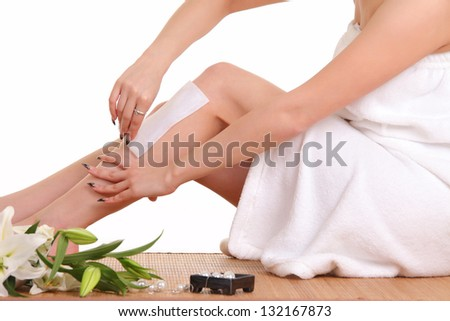 Removing hair from woman leg - stock photo