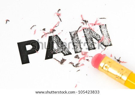 Removing Pain concept with eraser and pencil. - stock photo