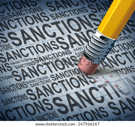 Removing sanctions lifting economic pressure as a global economy symbol for solutions to trade disputes as a pencil eraser erasing words as a metaphor for diplomatic success. - stock photo