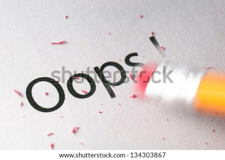 Removing word with pencil's eraser, Erasing Oops ! - stock photo