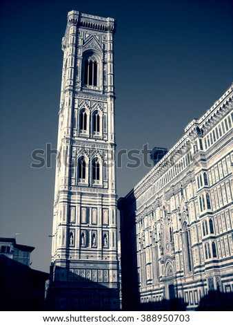Renaissance exterior of Florence cathedral, Italy, in black and white. Monochrome image filtered in retro, vintage style with extremely soft focus and red filter, high contrast dramatic effect. - stock photo