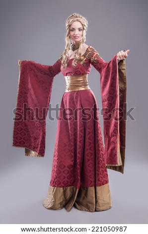 Renaissance fashion beauty. Classical beauty in a fancy renaissance dress and a matching hairdo. - stock photo
