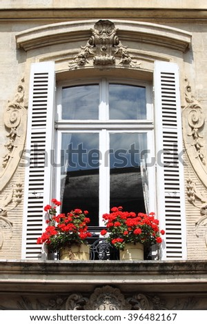 Renaissance window with red flowers - stock photo