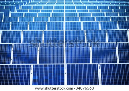 Renewable energy - arranged solar panels. Focus on front. - stock photo