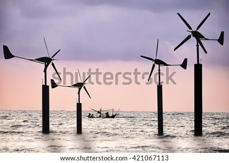 Renewable energy concept. Offshore wind turbines, clean energy background - stock photo