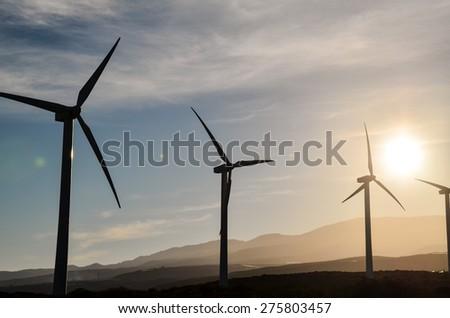 Renewable Energy Concept Windmil Farm at Sunset - stock photo