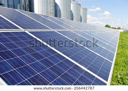 Renewable energy industry detail with photovoltaic panel - stock photo