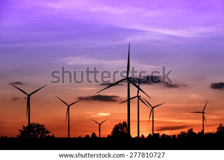 Renewable energy, Wind turbine farm silhouette at sunset in Thailand - stock photo