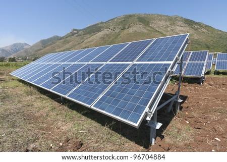 Renewable energy with solar panels - stock photo