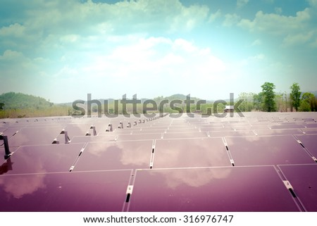 renewable solar energy Power plant  lomo retro style, a classical mood. : The concept of renewable energy. Clean energy Environmentally friendly The solar farm is a module of Tin film. - stock photo