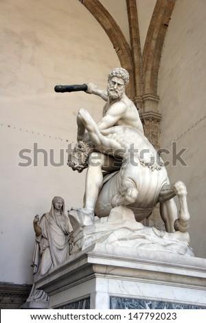 Rennaissnce statue of Hercules killing the Nesso Centaur, work of Giambologna. Located in the open-air gallery (Loggia dei Lanzi) on the Piazza della Signoria in Florence, Italy - stock photo