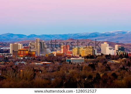 RENO - FEBRUARY 9: Reno skyline on February 9, 2013. It's known as The Biggest Little City in the World, famous for it's casinos and the birthplace of the gaming corporation Harrah's Entertainment. - stock photo