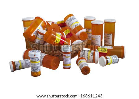 RENO, NEVADA-DECEMBER 23, 2013:  A collection of prescription pill containers representative of over medication prescribed by doctors in an effort to avoid possible law suits in a litigious society. - stock photo
