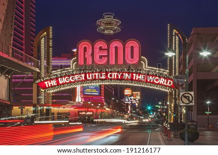 RENO, NEVADA - FEB 26, 2013: A Night shot of The Famous Arch (The Biggest Little City in the World) at Reno, Nevada. The Arch is lactated at Virginia Street. Reno is famous for casinos in Nevada. - stock photo