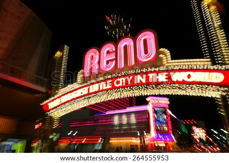 RENO, USA - AUGUST 12: Reno sign over Virginia street at night (shot with artistic blur technique) on August 12, 2014 in Reno, USA. Reno is the most populous Nevada city outside of the Las Vegas. - stock photo