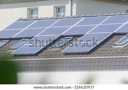 Renovated house, on the roof  a photovoltaic system. - stock photo