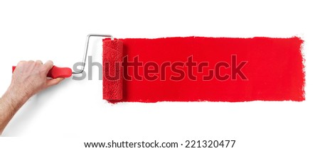 Renovating  Hand with paint roller isolated on white - stock photo