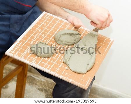 Renovation project for bathroom, new floor tiles. - stock photo