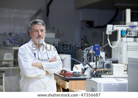 Renowned scientist/doctor in a research center/hospital laboratory looking confident - stock photo