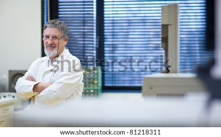Renowned scientist/doctor in a research center/hospital laboratory looking confident (color toned image; shallow DOF) - stock photo